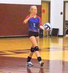 Olivia Casey serving