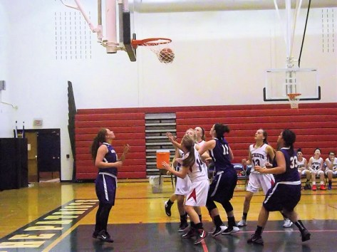 Giuliana Pritchard's 100th point goes through the net