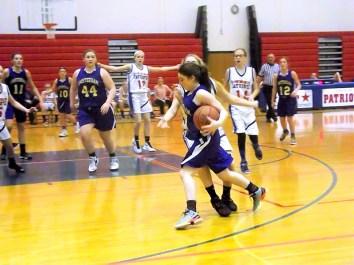 Junior Varsity player Mady Carmona moves to the basket