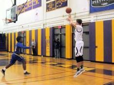 Rhodes shoots a three
