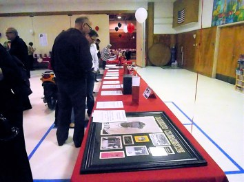 Looking over silent auction items