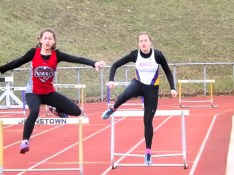 Kayla Dzikowicz (right) and BP's Gabrielle Larsen in the hurdles