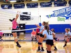 Jordan Marshall hits over the net