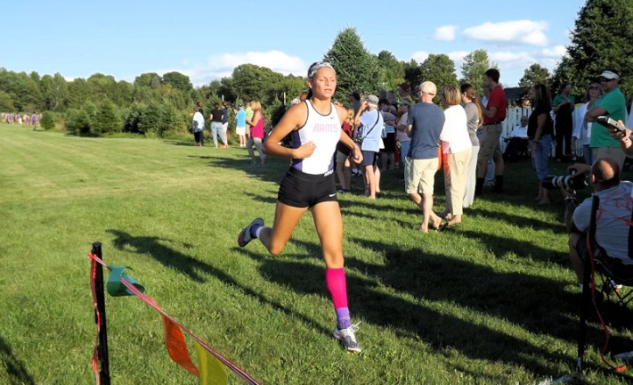 Lauren Santiago crosses the finish line