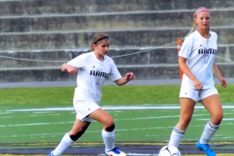 Lydia Iorio with ball and teammate Hope Adair