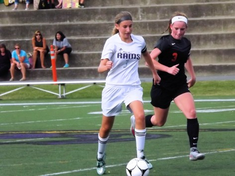 Lucia Liverio races for the ball with Amy Moreau