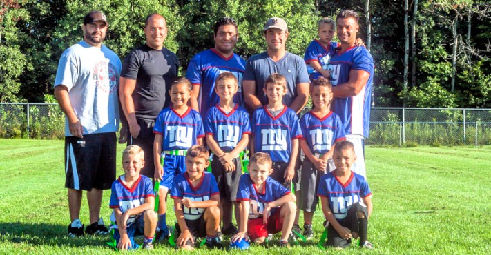Junior Division NFL Flag Championship Team: Bryce Greco, Pietro Russo, Rocco Natale, Christian Perez, Kye Carey, Jason Poremba, John Miller, Joseph Bernardo, head coach Rocco Natale and assistant coaches Pete Russo, Ruben Quinonez-Perez, John Miller and John Poremba. Photo provided.