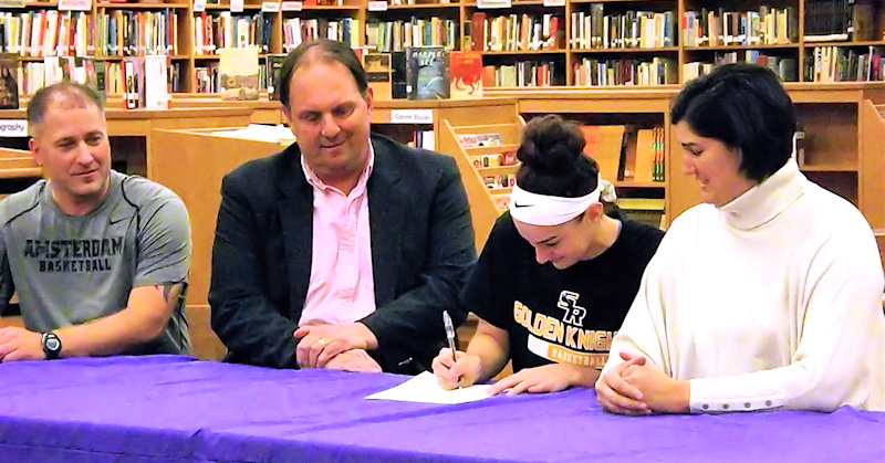 Nina Fedullo with parents and coach