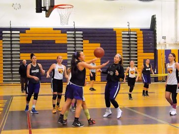 Grace Catena (left) and Brady Santiago reach for a rebound