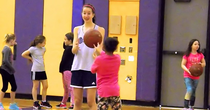Antonia May participating in a recent girls basketball clinic