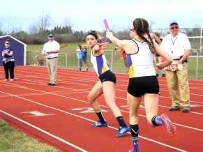 Kayla Sondrup hands off to Edena Sanchez in the 4x8 relay