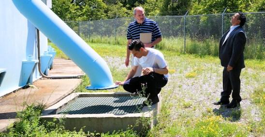 Assemblyman Angelo Santabarbara, Chief Plant Operator Randy Gardinier, Mayor Michael Villa, at Locust Ave water storage tank