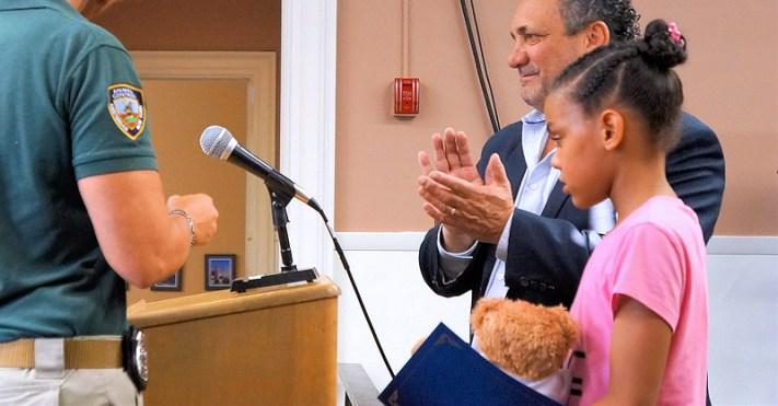 Lyana Tirado with Mayor Michael Villa (background), and Animal Control Officer Gina Kline (left)