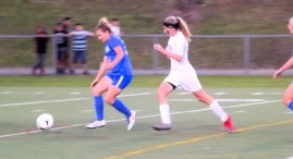 Lucia Liverio races to the ball