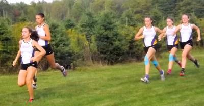 Olivia Lazarou and Lauren Santiago lead a pack of AHS runners