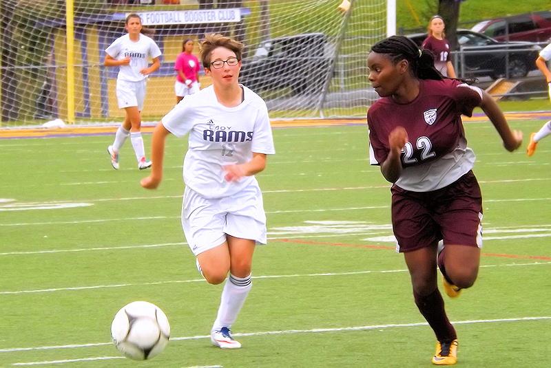 Alyssa Mosher with Beckford defending