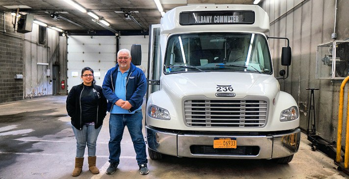 Transportation Director Fabrizia Rodriguez (l), bus driver Edward Walega (r)