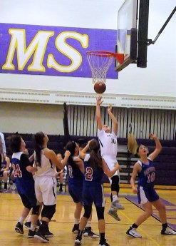 Jackie Stanavich goes in for a lay up