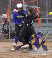 Megan Lamont slides in safely on a play at the plate