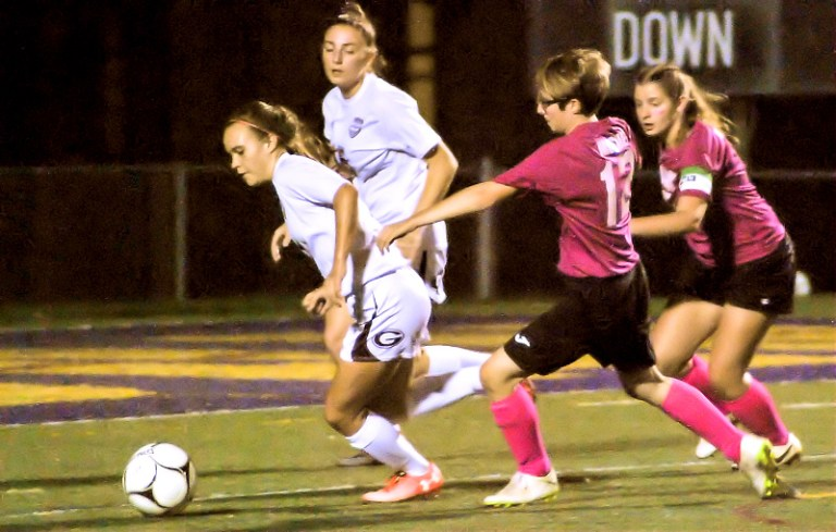 Ally Mosher (12) and Lydia Iorio pursue the ball against Gloversville