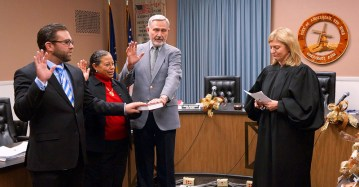 Judge Lisa Lorman swears in First Ward Alderman Pat Russo, Third Ward Alderwoman Irene Collins, and Fourth Ward Alderman Dave Dybas before Tuesday's council meeting.