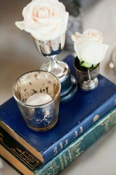 Vintage bookstack used to prop votives on the table