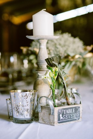 Candlestick, mercury votive and petit fleur planter used for a table number