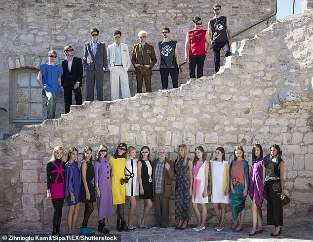 As well as shaking up fashion with bubble-dresses and geometrical designs, Cardin was also one of the first to bring high fashion to the masses by selling collections in department stores from the late 1950s. Pictured: Cardin (bottom row, centre) with models wearing his clothes in 2017 at a fashion show in Cardin's chateau in the village of Lacoste that once belonged to the Marquis de Sade.
