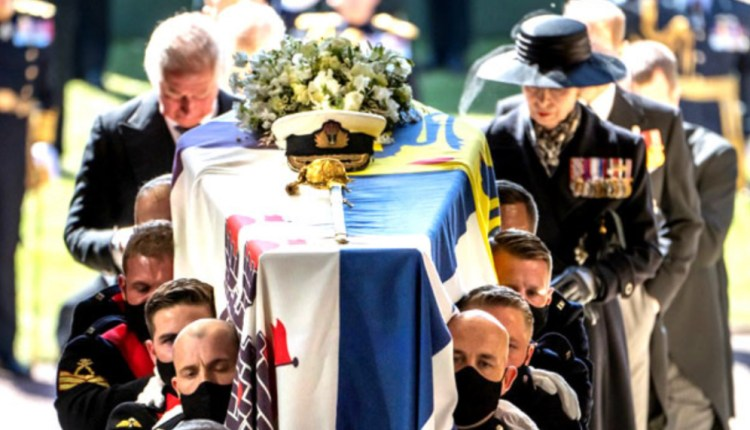 Pall Bearers carry the coffin of Britain's Prince Philip, Duke of Edinburgh, followed by members of the Royal family inside St George's Chapel in Windsor Castle in Windsor, west of London, on April 17, 2021. Danny Lawson / POOL / AFP