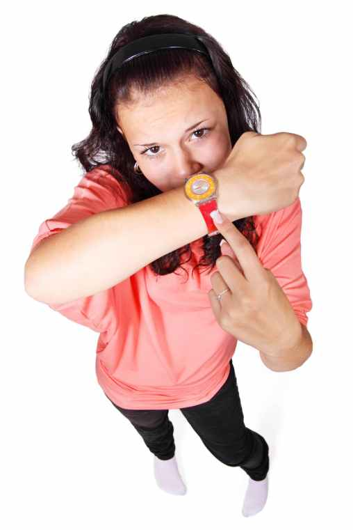 woman in red yellow round analog watch