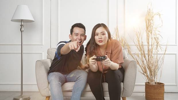 boy and girl holding game pad