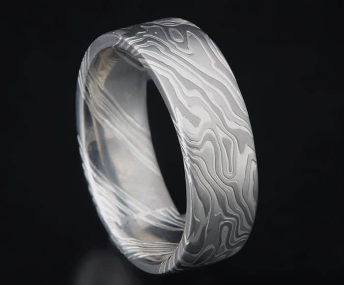 custom white metals wedding ring
