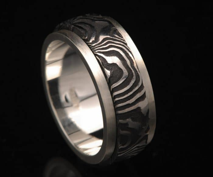 blackened damascus steel and silver ring