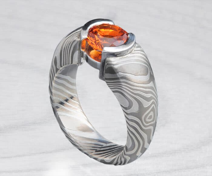 orange sapphire mokume engagement ring