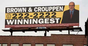 The disclaimer on the Brown & Crouppen billboard near Hwy 40/64 and 21st. exit in downtown St. Louis, Mo.  Photo By: KAREN ELSHOUT
