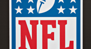 A National Football League (NFL) logo is displayed during a media preview of the New York International Auto Show (NYIAS) in New York, U.S., on Thursday, April 1, 2010. The show is open to the public April 2 - 11. Photographer: Daniel Acker/Bloomberg