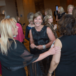 """Women's Justice Award honoree Beverly Weber speaks with other guests of the Women's Justice Awards. Weber was named a """"rising star"""" by Missouri Lawyers Media."""