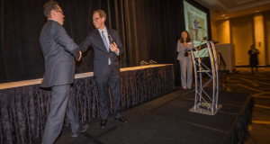 ACLU of Missouri Legal Director Anthony Rothert walks up to the podium to receive the Lawyer of the Year Award from Missouri Lawyers Media publisher Richard Gard Friday at the Hilton in downtown St. Louis. Photo by: Karen Elshout