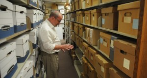 Stuart Hinds, assistant dean for Special Collections & Archives at the University of Missouri-Kansas City, is working to organize dozens of boxes of private papers from U.S. Supreme Court Justice Charles Evans Whittaker. The justice served on the court from 1957 to 1962, the only Missourian to do so. Photo by Scott Lauck