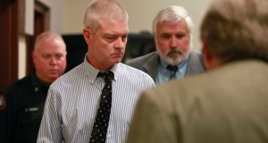 Craig Michael Wood, left, enters the courtroom for a hearing Wednesday, March 26, 2014, in Springfield, Mo. Wood, who was a middle school football coach, is charged with first-degree murder, armed criminal action and child kidnapping in connection with 10-year-old Hailey Owens' death. (AP Photo/The Springfield News-Leader, Nathan Papes, Pool)