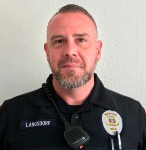 North County Police Cooperative officer Michael Langsdorf is shown in an undated photo provided by the North County Police Cooperative. Officer Langsdorf was shot and killed Sunday, June 23, 2019 in Wellston, Mo., near St. Louis while responding to a bad check complaint at a food market. (North County Police Cooperative via AP)