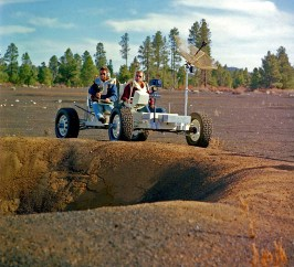 This undated photo provided by the U.S. Geological Survey Astrogeology Science Center shows Apollo 15 astronauts Jim Irwin, left, and Dave Scott driving a prototype of a lunar rover in a volcanic cinder field east of Flagstaff, Ariz. The rover, named Grover, now is on display at the science center. Photo by U.S. Geological Survey Astrogeology Science Center via AP