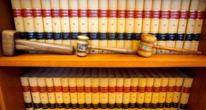 File photo showing gavels and law book (AP Photo/Jeff Chiu, file)