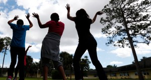 Girls dance as they do exercises at a shelter for migrant teenage girls, in Lake Worth, Fla. AP Photo by Wilfredo Lee
