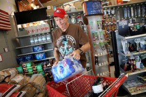 James Cooke is shown buying water bottles along with propane tanks and batteries at a ACE Hardware store as he prepares for a possible power shutdown in Los Gatos, Calif. Millions of people were poised to lose electricity throughout northern and central California after Pacific Gas & Electric Co. announced Tuesday it would shut off power in the largest preventive outage in state history to try to avert wildfires caused by faulty lines. Photo by Anda Chu of San Jose Mercury News via AP