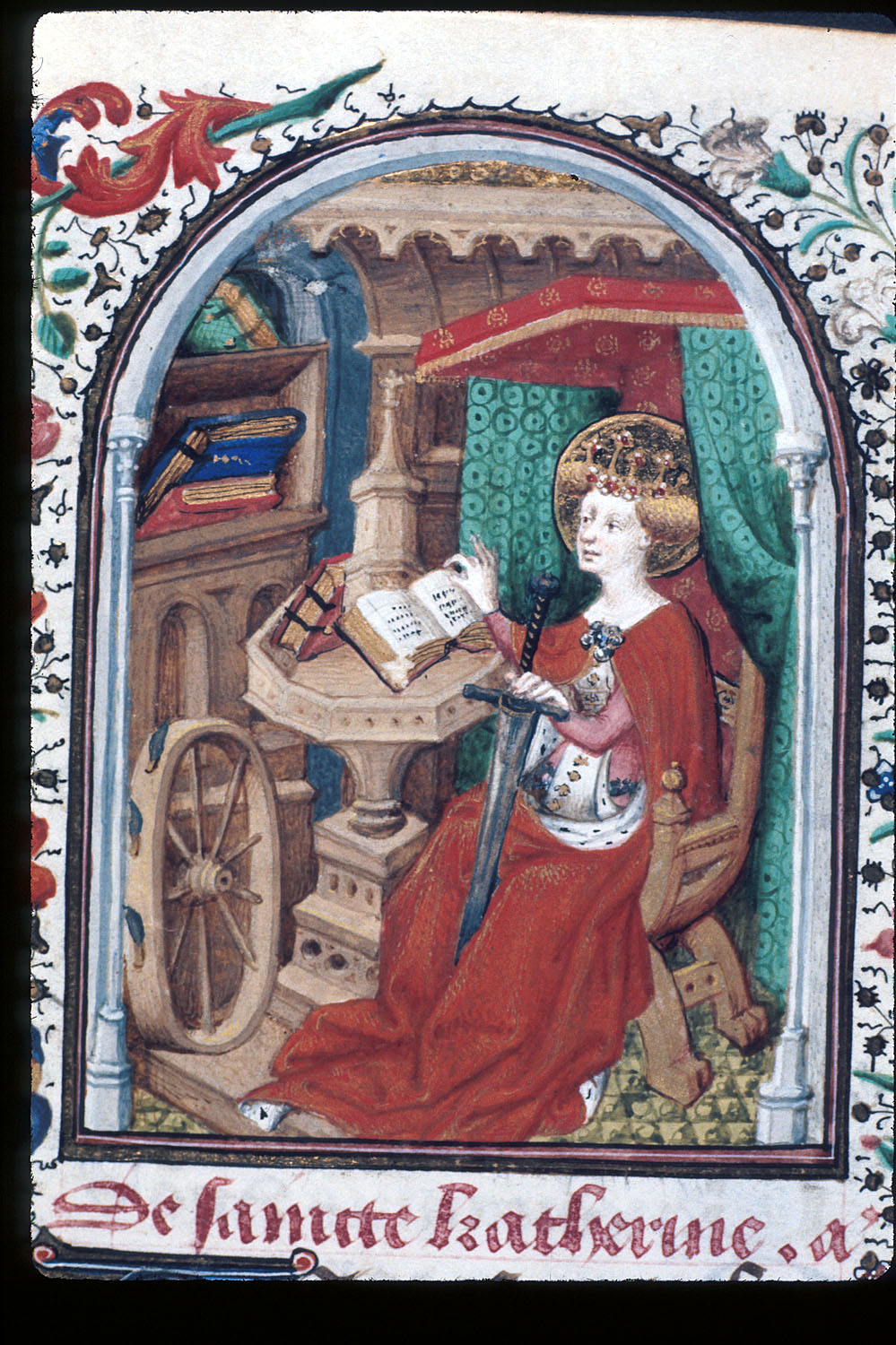 Detail of a miniature of Katherine of Alexandria, seated at a table and reading a book, with the attributes of her martyrdom (spiked wheel and sword) nearby, at the beginning of her suffrage.  British Library Yates Thompson 3 f. 281v  (public domain)