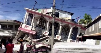 A view of a collapsed building following an earthquake, in Les Cayes, Haiti, in this still image taken from a video obtained by Reuters on August 14, 2021. REUTERS TV via REUTERS