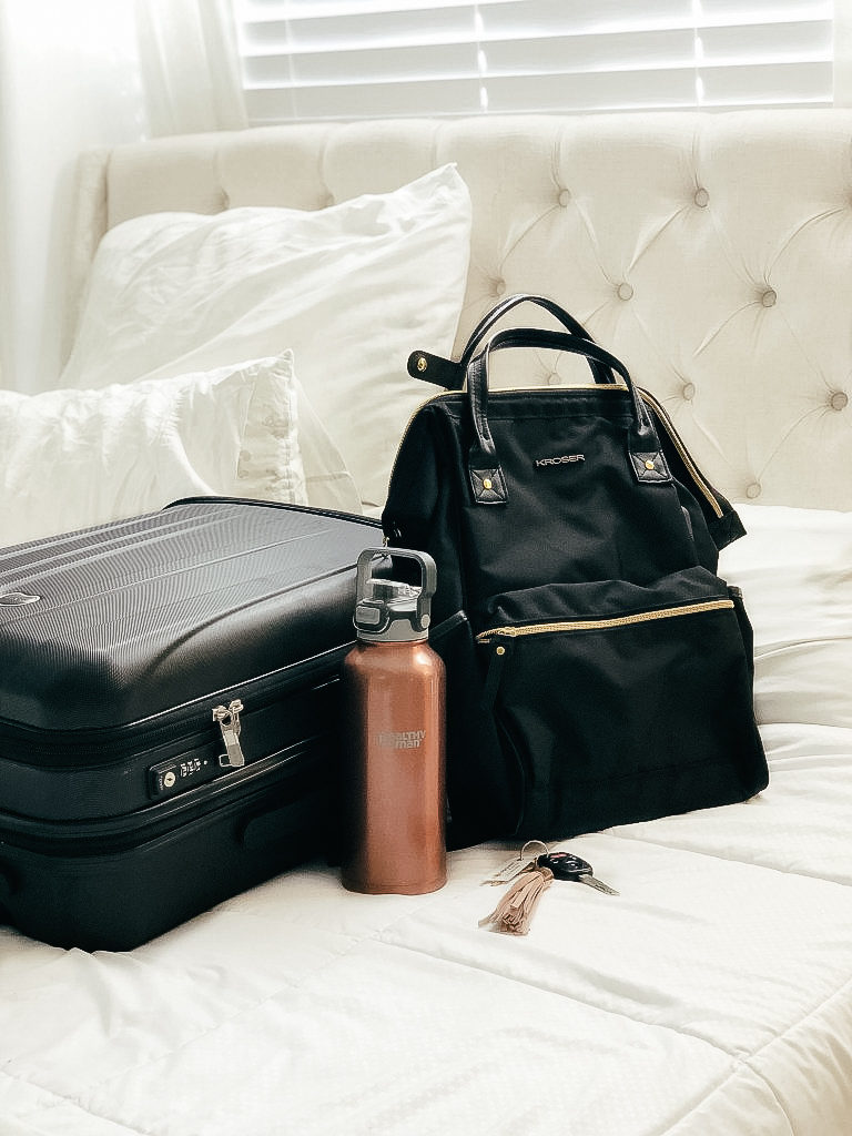 travel essentials and packing tips for easy and healthy travel | suitcase, carry on + snack bag | healthy travel hacks | gluten free travel