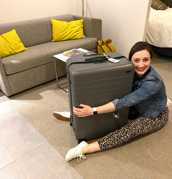 image of mollyann hugging the large suitcase