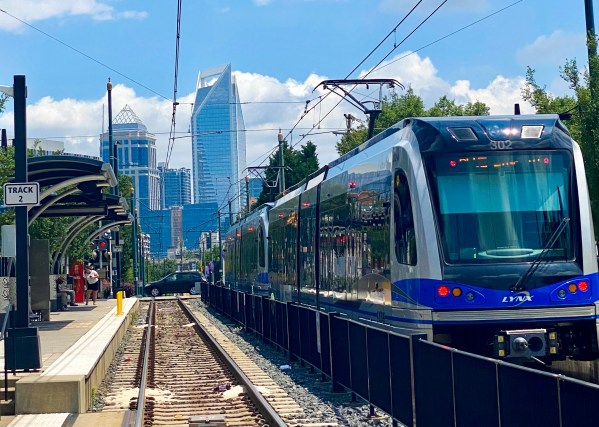 photo of Charlotte skyline and light rail